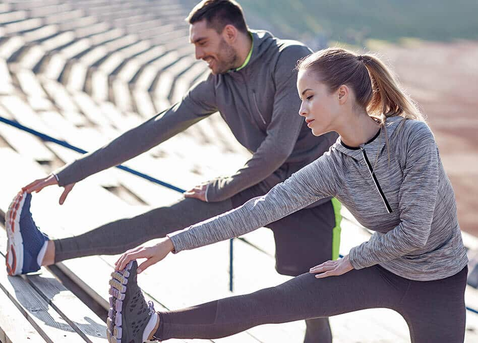 man and woman training outside