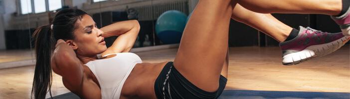 Muskelaufbau bei Frauen Bauch Training Sport